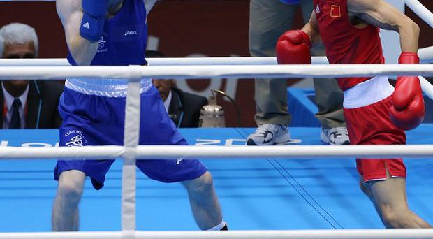Paddy Barnes, left, in action at the ExCeL arena in London