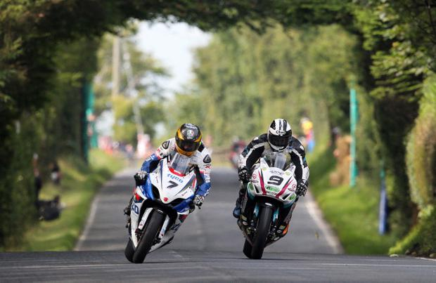 Guy Martin is wheel to wheel with Michael Dunlop during the McKinstry Skip Hire Superbike Race in the Ulster Grand Prix at Dundrod