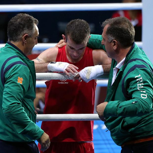 Joe Nevin, centre, lost to Luke Campbell in the men's boxing 56kg bantamweight final