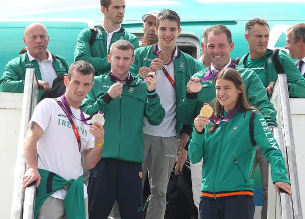 Team Ireland's Olympic medal winners (left to right) John Joe Nevin, Paddy Barnes, Michael Conlon, Cian O'Connor and Katie Tayor arrive with the rest of the team at Dublin Airport