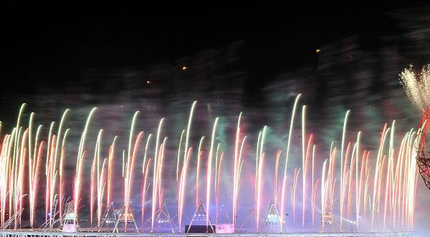 Fireworks light up the sky over the Olympic Stadium and the Orbit during the closing ceremony of the London 2012 Olympics Games