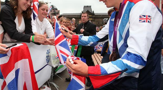 Great Britain's Jonathan Brownlee signs autographs in Millennium Square, Leeds