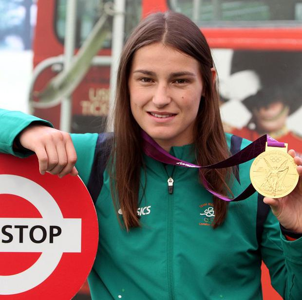 Katie Taylor flew a Tricolour from the plane flying the Irish Olympic team home