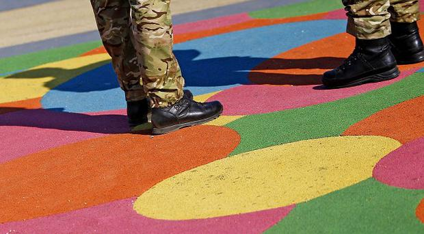 Soldiers stand outside the Olympic Stadium in London
