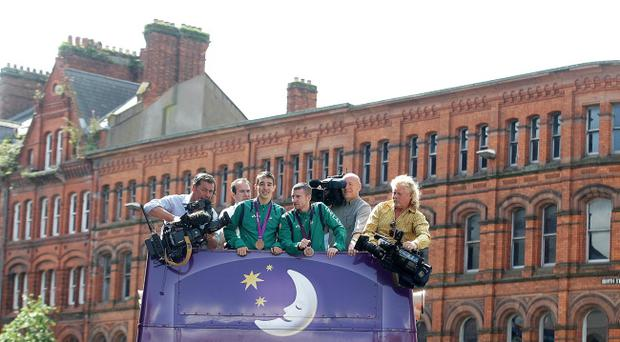 Crowds lined the streets of Belfast city centre as Olympic bronze medalists, Paddy Barnes and Michael Conlon travelled from Writer's Square to City Hall in an open-top bus