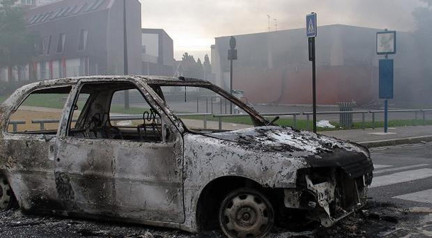 A burned out car from the riots in Amiens (AP)