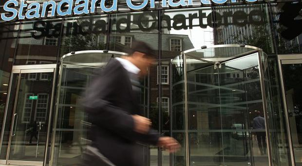 Standard Chartered Bank has settled a case with US regulators over claims it plotted with Iran's government to launder billions of dollars