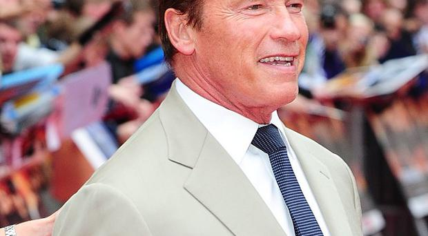 Arnold Schwarzenegger arrives for the UK premiere of The Expendables 2