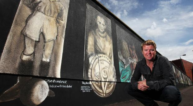 Belfast artist Ed Reynolds pictured at the unveiling of his new mural at Sandy row
