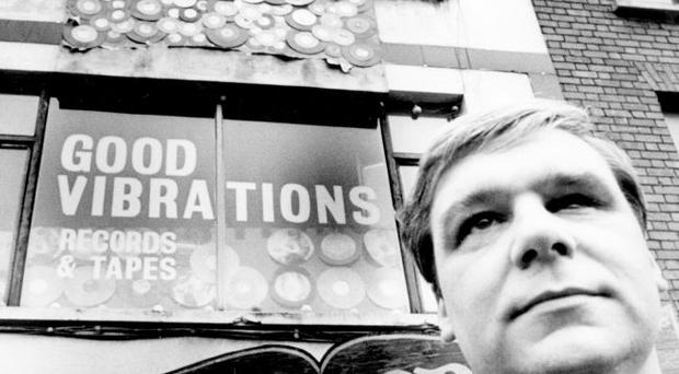 Terri Hooley outside his Good Vibrations record shop in 1983
