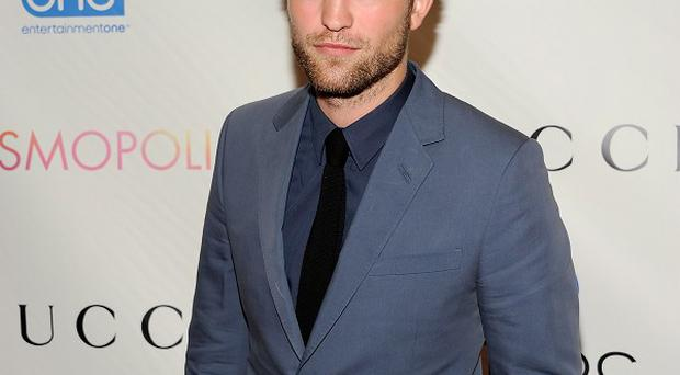 Robert Pattinson was putting on a brave face as he did publicity for Cosmopolis in New York