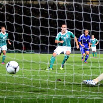 Martin Patterson, centre, struck a late penalty as Northern Ireland drew against Finland