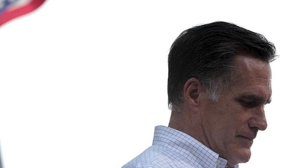 Mitt Romney has accused Barack Obama of being desperate to stay in power (AP)