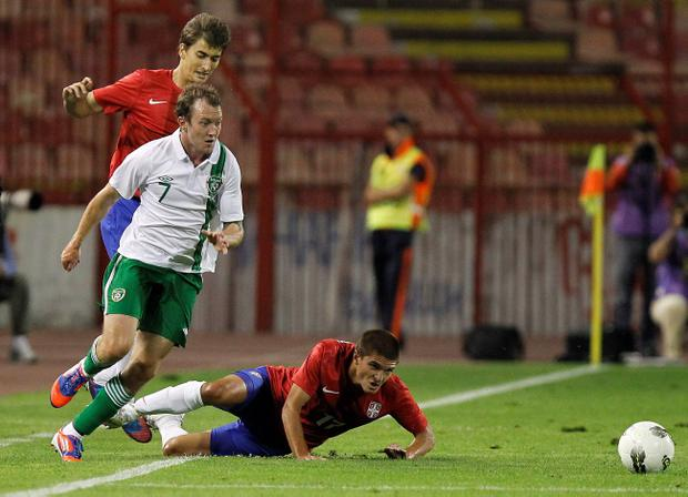 BELGRADE, SERBIA - AUGUST 15: Aiden McGeady of Republic of Ireland is challenged by Aleksandar Ignjovski (R) of Serbia during the International friendly between Serbia and Ireland at Stadium Marakana on August 15, 2012 in Belgrade, Serbia. (Photo by Srdjan Stevanovic/Getty Images)