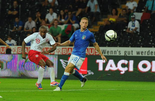 BERN, SWITZERLAND - AUGUST 15: Jermain Defoe of England scores their second goal to make it 2-1 during the international friendly match between England and Italy at Stade de Suisse, Wankdorf on August 15, 2012 in Bern, Switzerland. (Photo by Michael Regan/Getty Images)