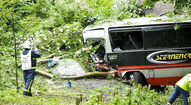 Fire and rescue crews at the scene after a US punk rock band's tour bus crashed and fell 30ft over a viaduct in Bath