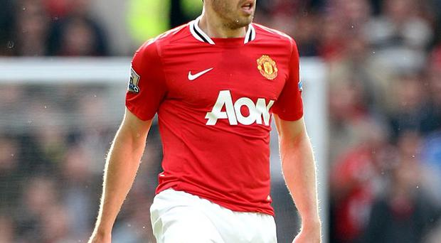 Michael Carrick, pictured, would love to see Robin van Persie at Manchester United
