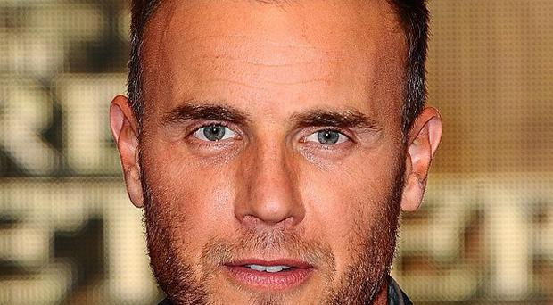 Gary Barlow is thought to be staying in the UK