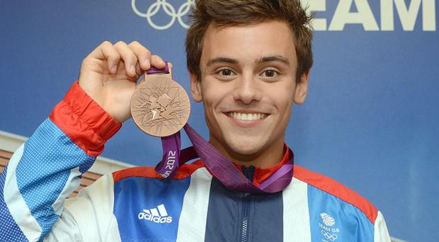 Tom Daley, who won a bronze diving medal, scored an A in his Spanish A-level