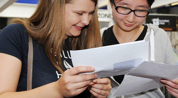 Students Elizabeth Brittain and Ye Zhang compare their A-level results at Hillsborough College, Sheffield