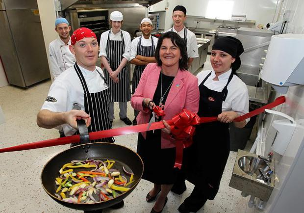 Tourism Minister Arlene Foster with Ciaran Sansome, head chef, alongside hospitality apprenticeship students Paulina Bienko, Stefan Taylor, Ryan Harrison, Brian McArdle and Mark Doran at Burrendale Hotel