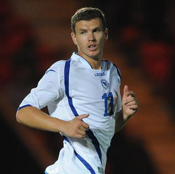 Edin Dzeko played for Bosnia-Herzegovina with a knee injury