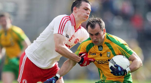 Karl Lacey (right) is determined to bring the Sam Maguire back to Donegal next month