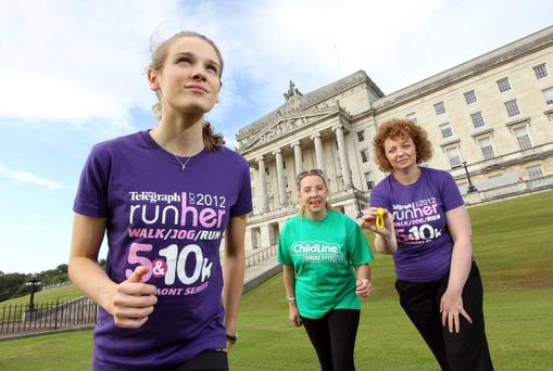 Athlete Katie Kirk (left) who lit the Olympic Games cauldron in London, Sports Minister Caral Ni Chuilin (right) and ChildLine volunteer Joanne McMaster at the launch of Runher