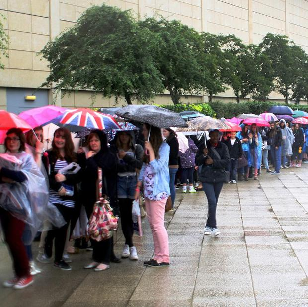 People brave the rain ahead of Tom Daley's book signing at The Mall