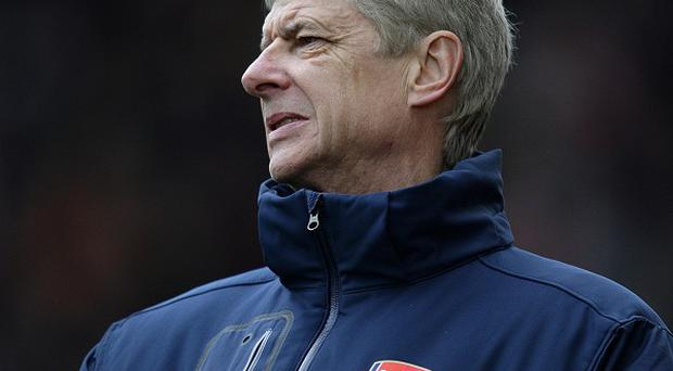Arsene Wenger, pictured, thinks Sir Alex Ferguson may struggle to juggle his strikers