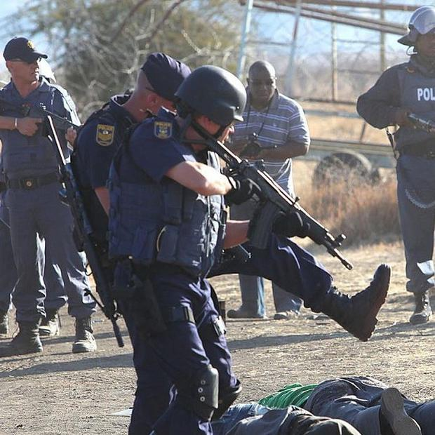 Armed police after opening fire on a crowd at the Lonmin Platinum Mine near Rustenburg, South Africa (AP)