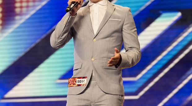 Supermarket worker Jahmene Douglas impresses the X Factor judges