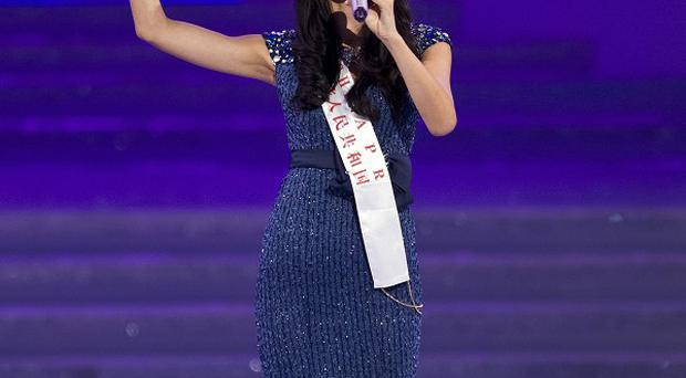 Newly-crowned Yu Wenxia of China sings on stage during the Miss World 2012 beauty pageant (AP)