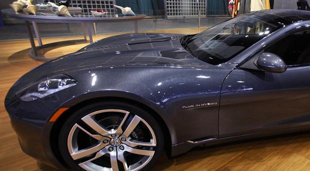 Fisker's Karma can go 30 to 40 miles on battery power (AP/Damian Dovarganes)