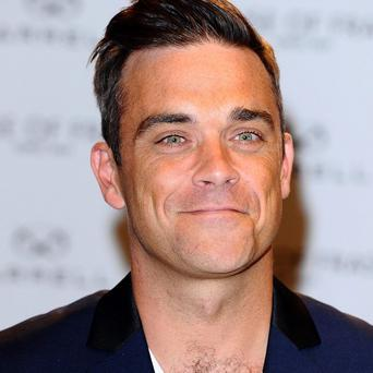 Robbie Williams apparently wants a permanent base in the UK