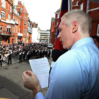 Julian Assange makes an address from inside the Ecuadorian embassy in London