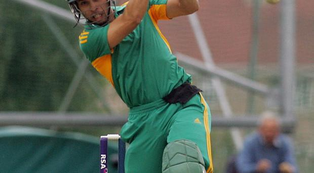 South Africa's Farhaan Behardien hits a six on his way to an unbeaten 88
