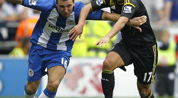Eden Hazard, right, was labelled 'outstanding' by Chelsea manager Roberto Di Matteo