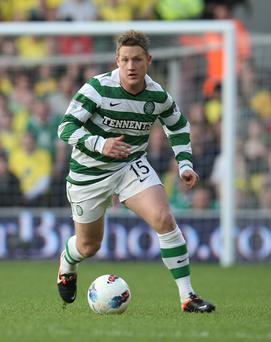 A late Kris Commons goal denied Ross County
