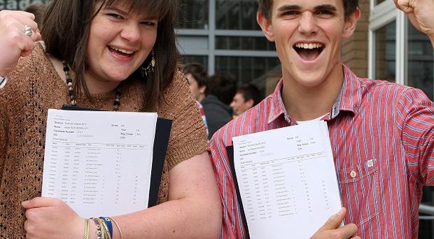 Ballymena Academy students Helen McKelvey and Ian Wilson celebrate their A-level results