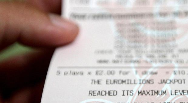 A shop worker in Oldham tried to claim a winning lottery ticket belonging to customers