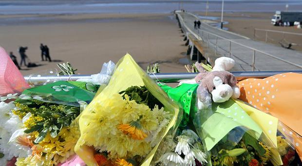 Floral tributes left at the scene in Burnham-on-Sea where the search for four-year-old Dylan Cecil continues
