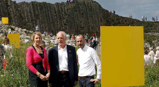 Kathryn Thomson, Northern Ireland Tourist Board chief operating officer, German artist Hans Peter Kuhn and Hugh Mulholland curator for the MAC with a yellow flag
