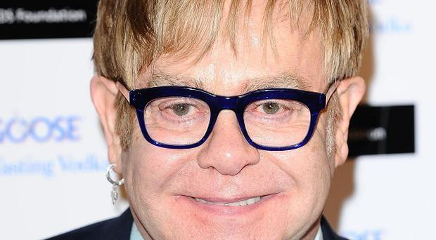 Sir Elton John said his son does not yet have an inkling of his father's fame