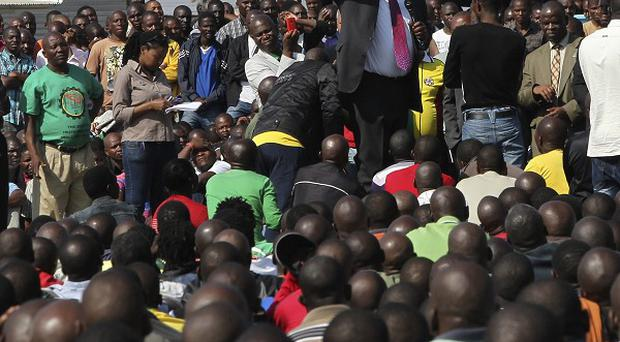 Congress of the People leader Mosiuoa Lekota addresses workers at the Lonmin mine near Rustenburg, South Africa (AP)