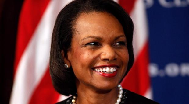 Augusta National Golf Club will admit two women, former Secretary of State Condoleezza Rice and South Carolina businesswoman Darla Moore, for the first time