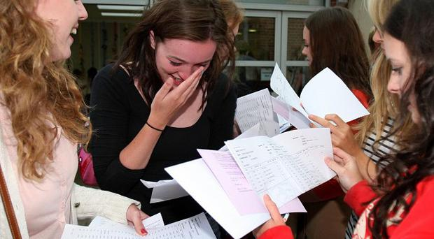 A study found that teenagers picking up GCSE results this week will face a 'postcode lottery' in finding jobs