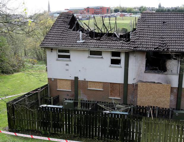 Charred remains: the complex in which Betty and Deirdre McGirr died after an arson attack