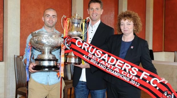 Sports Minister Carál Ní Chuilín (right) was on hand to congratulate Crusaders skipper Colin Coates and manager Stephen Baxter (centre)