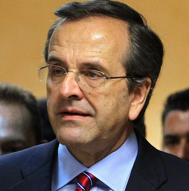 Greek premier Antonis Samaras says his country needs more time to implement tough spending cuts (AP)